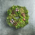 Christmas decorative wreath over grey concrete wall background, square crop Royalty Free Stock Photo