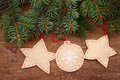 Christmas decorative toys on a wooden background paper with fir tree branches Stock Images