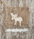 Christmas deer made of birch bark on the burlap Royalty Free Stock Image