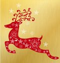 Christmas deer with snow flakes and gold background Royalty Free Stock Photography