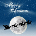 Christmas design of Santa flying on full blue moon Royalty Free Stock Photography
