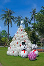 Christmas design tree in tropics and snowman on new year concept Stock Photos