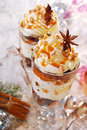 Christmas dessert with gingerbread whipped cream and caramel plum walnuts in glass Stock Photo