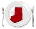 Christmas dinner, napkin folded as a santa claus boots Royalty Free Stock Photo