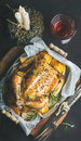Christmas dinner with roasted whole chicken, decorative candles and wine Royalty Free Stock Photo