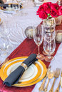 Christmas dinner table formal setting for with gold plate china sterling sliverware and red roses Royalty Free Stock Photo