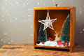 Christmas diorama with pine trees and decorations on wooden table Royalty Free Stock Photo