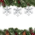 Winter border with white and blue snowflakes on blue blurred soft background. Christmas and New Year holiday wallpaper