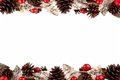 Christmas double border with rustic wood tree ornaments, baubles and pine cones isolated on white Royalty Free Stock Photo