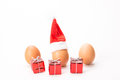 Christmas eggs egg with hat isolated on white background Royalty Free Stock Photos