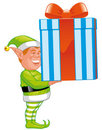 Christmas elf with gift Stock Photo