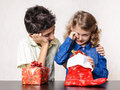 Christmas emotion girl crying with present and decorations boy comforting her Royalty Free Stock Image
