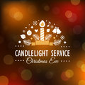 Christmas Eve Candlelight Service Invitation Card on Blurry Bokeh Background Royalty Free Stock Photo