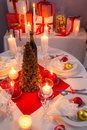 Christmas eve spirit depicted on a traditional table in home Stock Photos