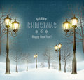 Christmas evening winter landscape with lampposts. Royalty Free Stock Photo