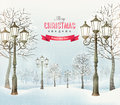 Christmas evening winter landscape with vintage lampposts. Royalty Free Stock Photo