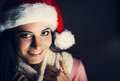Christmas face mysterious woman in santa hat at dark background Stock Photos