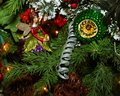 Christmas Fairy sitting on branch with other Ornaments on Tree Royalty Free Stock Photo
