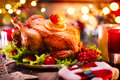 Christmas family dinner. Christmas holiday decorated table with turkey Royalty Free Stock Photo