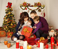Christmas Family Open Present Gift Box, Mother Father Baby Child Royalty Free Stock Photo