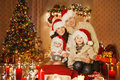 Christmas Family Portrait In Home Holiday Room, at Santa Hat Royalty Free Stock Photo