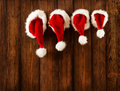 Christmas Family Santa Claus Hats Hanging on Wood Wall, Xmas Hat Royalty Free Stock Photo