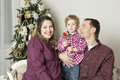 Christmas family a with toddler is celebrating Royalty Free Stock Photography