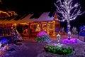 Christmas fantasy - lodge and tree lights Stock Photos