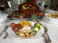 Christmas feast dinner of turkey with stuffing and vegetables on a dining table Royalty Free Stock Image