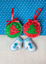 Christmas felt toys handmade from on blue background with snowflakes Royalty Free Stock Images