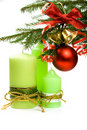 Christmas fir, ball, ribbon, bells and candles Royalty Free Stock Photos