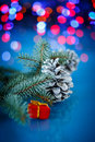 Christmas fir cones on a blue background Royalty Free Stock Photos