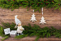 Christmas fir tree, Christmas tree toys, gifts on old wooden board background. Toned