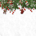 Christmas fir tree with cookie,holly and decoration on white Royalty Free Stock Photo