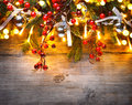 Christmas fir tree decorated over wooden background