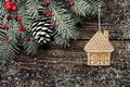 Christmas fir tree with decoration on dark wooden background Royalty Free Stock Photo