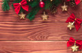 Christmas fir tree with decoration on dark wooden board. Soft fo Royalty Free Stock Photo