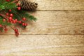 Christmas fir tree with decoration on a wooden Royalty Free Stock Photo