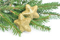 Christmas fir tree and glitter stars isolated on white background Stock Photos