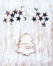 Christmas fir tree made of birch bark with stars on old wood background Stock Images