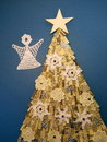Christmas fir tree with star made from paper and crochet snowflakes Royalty Free Stock Photos