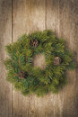 Christmas fir wreath on vintage wooden background vertical Stock Photo
