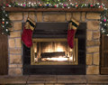 Christmas fireplace hearth and stockings landscape hanging over the Royalty Free Stock Photography