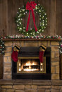 Christmas Fireplace Hearth with Wreath and Stockings Royalty Free Stock Photo