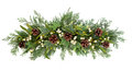 Christmas floral display decoration with mistletoe ivy pinecones and winter greenery over white background Stock Photo