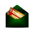 Christmas fly air ticket in green envelope isolated over white background Stock Photography
