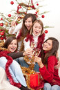 Christmas:Four young woman toasting with champagne Royalty Free Stock Photos