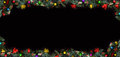 Christmas framework, black background decorated with balls and tree branches and space for a greeting text Royalty Free Stock Photo