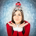 Christmas is funnier with presents beautiful young caucasian brunette woman wearing santa costume gift box on her head unusual Royalty Free Stock Photography