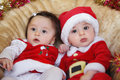 Christmas funny small kids in santa claus clothes twins a boy and a girl Royalty Free Stock Image